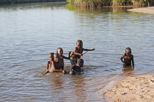 African boys playing in a distributary of the River Gambia