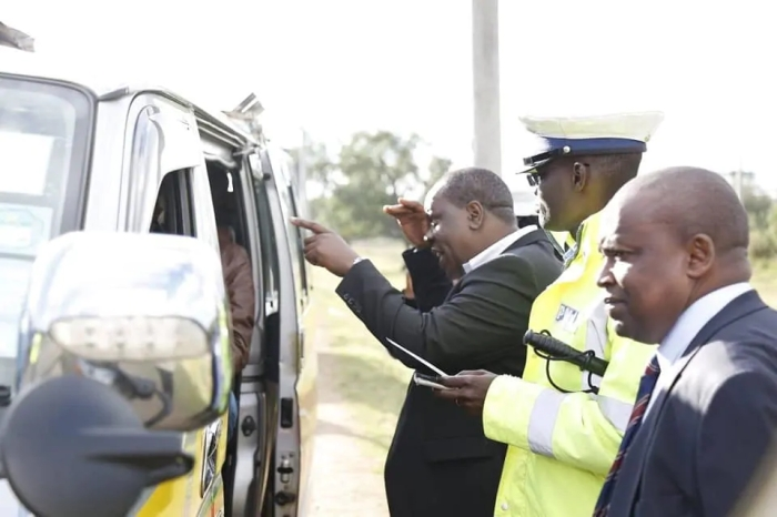 During his spot check on the ever busy highway, no nonsense Matiang'i witnessed the arrest of a matutu driver who had flouted the recently reinstated michuki rules. Photo: Joe Muhahami
