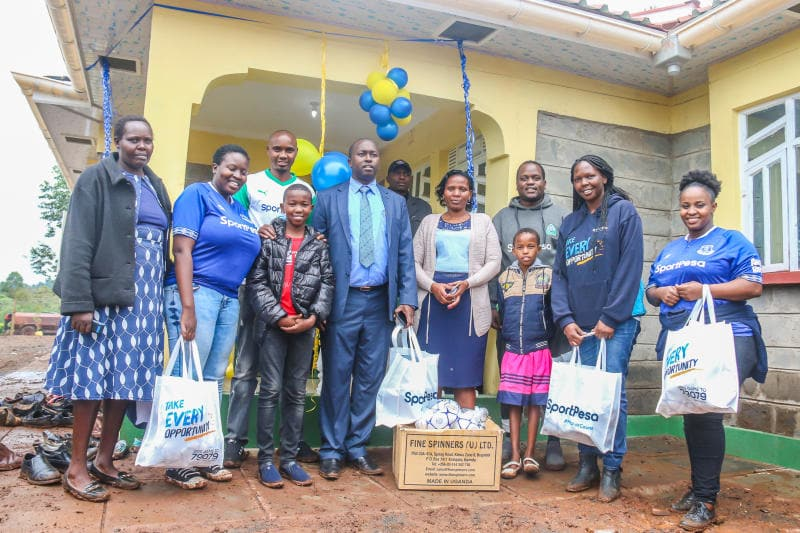 Cosmas Korir (in blue suit) and his family during launch of his new house worth KSh 4 million. Photo: (COURTESY)
