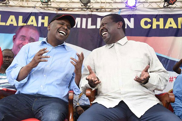Baringo Senator Gideon Moi (left) and ANC party leader Musalia Mudavadi enjoy each other's company during a fundraiser in Kakamega Town on December 1, 2018 (courtesy)