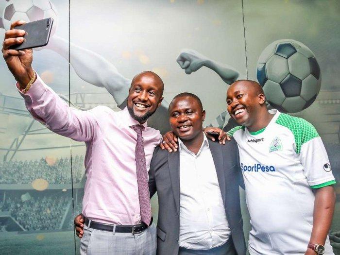 SportPesa CEO Ronald Karauri with Gordon Ogada and new mega jackpot winner Cosmas Korir