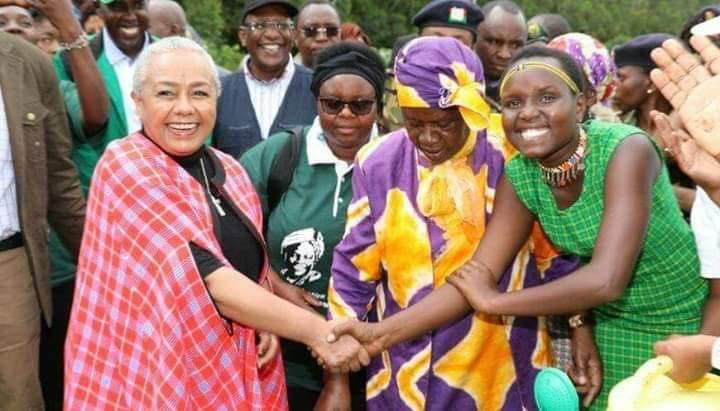 First Lady Margaret Kenyatta with Lily Tanui During a tree planting excercise