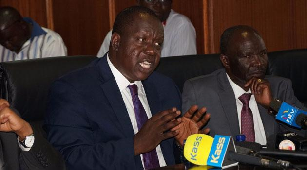 Interior CS Fred Matiang'i and PS Gordon Kihalangwa during a previous press conference.