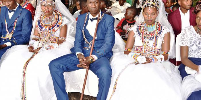 tom-mako-27-with-his-two-wives-elizabeth-silamoi-left-and-joyce-tikoyian-23-on-december-11