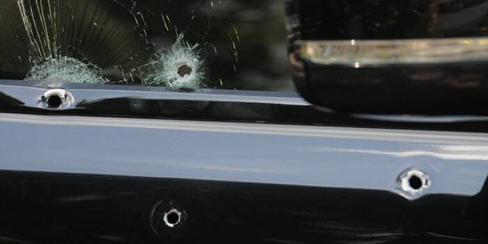 windshield_sprayed_with_bullets_0