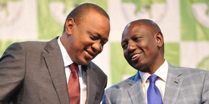 President Uhuru Kenyatta and DP William Ruto chat while at the Bomas of Kenya during the announcement of 2017 General Election